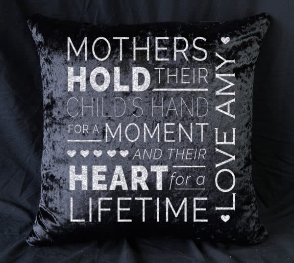 Personalised Mothers Hold Their Child's Hand In Black Crushed Velvet Cushion With White Glitter Vinyl