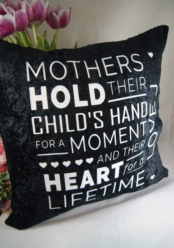 Personalised Mothers Hold Their Child's Hand Black Crushed Velvet Cushion With White Glitter Vinyl
